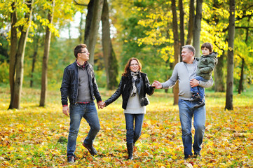 Happy family walking together in a park