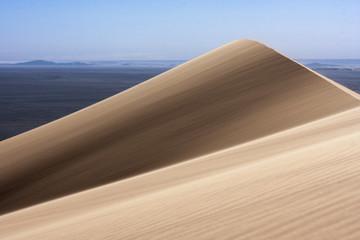 Sand dunes hit by wind in the Sahara desert