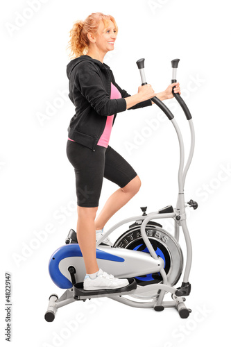 Mature woman excersing on a cross trainer
