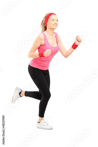 Full length portrait of a young female running