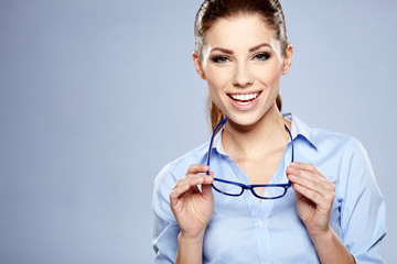 business woman in glasses on sky background