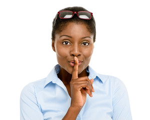 Happy African American business woman finger on lips isolated on