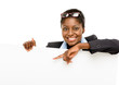 Happy African American business woman showing empty copey space