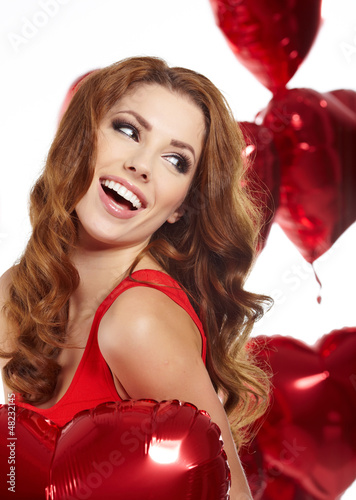 woman with red heart balloon