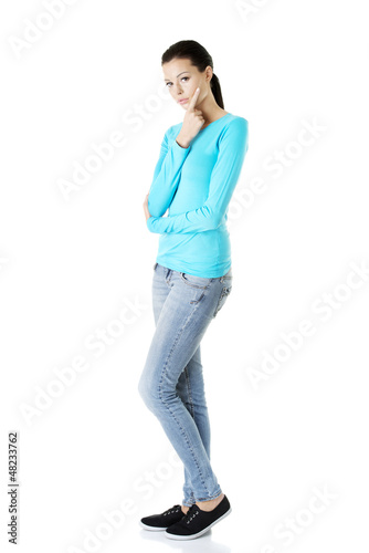 Thoughtful female student, isolated on white