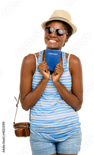 Happy African American woman tourist holding passport isolated o