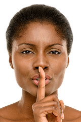 Cute African American woman finger on lips isolated on white bac