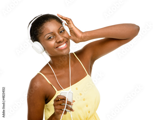 Beautiful African American Woman dancing listening to music isol