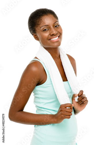 Happy healthy young black woman wearing gym clothes isolated on