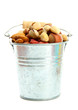 assortment of tasty nuts in pail, isolated on white
