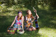 Hippie girls with a guitar outdoor