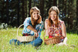 Happy young girls with a fruit basket