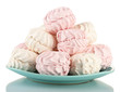Marshmallows on color plate isolated on white