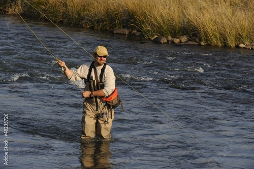 flyfishing for trout Umzimkulu river, Underberg, Natal.