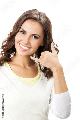 Beautiful woman showing call me gesture, isolated