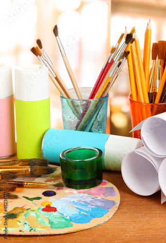Artistic equipment: paint, brushes and art palette