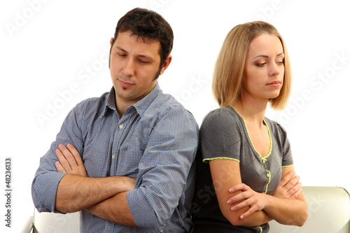 Young couple turning away from each other isolated on white