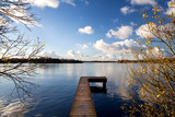 wooden pier on big lake in autumn