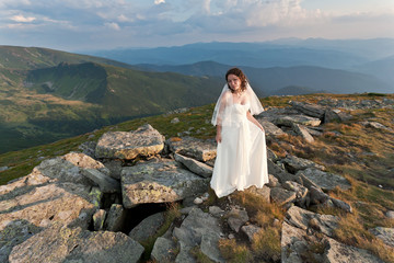 Bride in mountains.