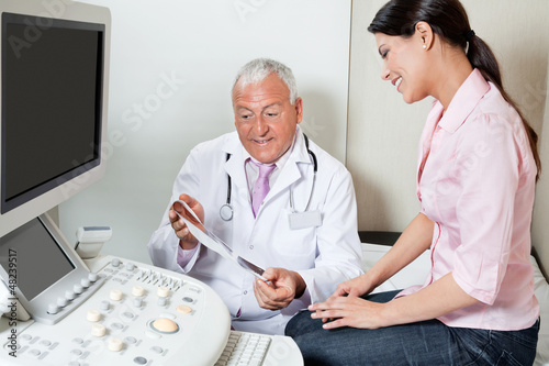Radiologist Showing Ultrasound Print To Patient