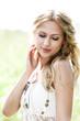 Beautiful blond girl in meadow
