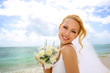 Portrait of beautiful bride standing by the beach