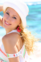 Attractive blond woman standing by the sea