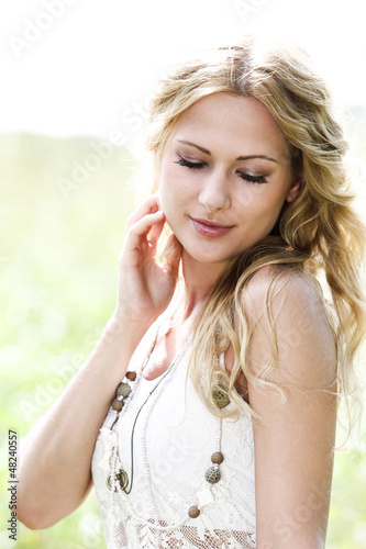Beautiful blond girl in meadow