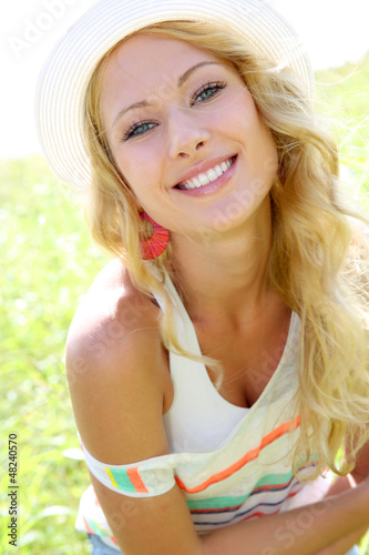 Beautiful blond girl in countryside