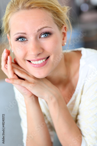 Portrait of beautiful blond woman with hand on chin