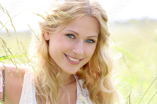 Portrait of beautiful blond girl in countryside