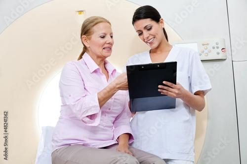 Nurse With Female Patient
