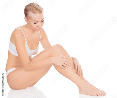 Woman in white underwear sitting on a floor