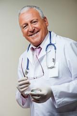 Doctor Holding Sterilized Syringe