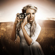 Young Female Photographer With Vintage Camera