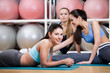 Group of sportswomen have a rest in the gym