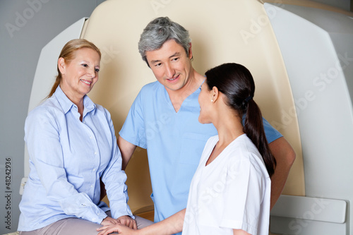 Technicians With Mature Female Patient