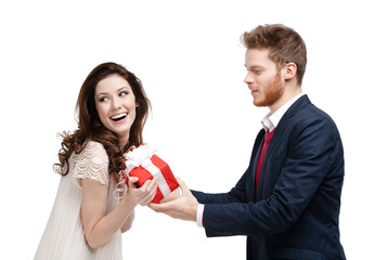 Handsome man makes present to his girlfriend, isolated on white