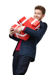 Smart young man carries a lot of heavy presents