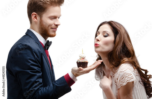 Man presents birthday sponge cake to his lovely girlfriend