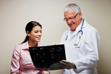 Radiologist Showing X-ray To Patient