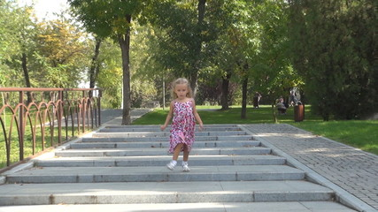 Child Running the Stairs in Park for Playing