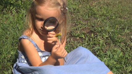 Child Looking at a Dandelion with a Magnifier