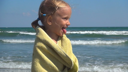 Child Spinning in her Towel after Bathing in the Sea