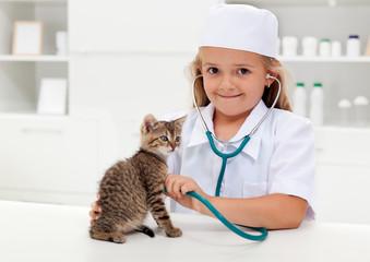 Little girl playing veterinary
