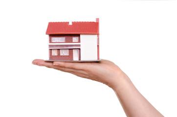 Haus auf einer Hand