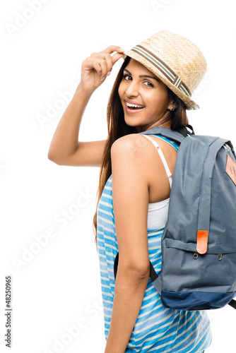 Pretty Indian woman tourist carrying backpack isolated on white