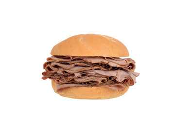 Large roast beef on a bun sandwich