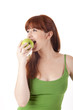 Beautiful young woman eating apple