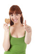 Beautiful young woman eating diet biscuits